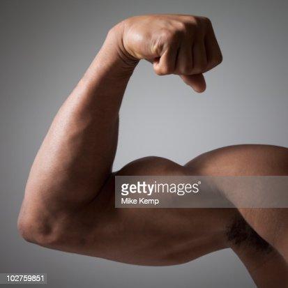Flexed muscular arm : Stock Photo