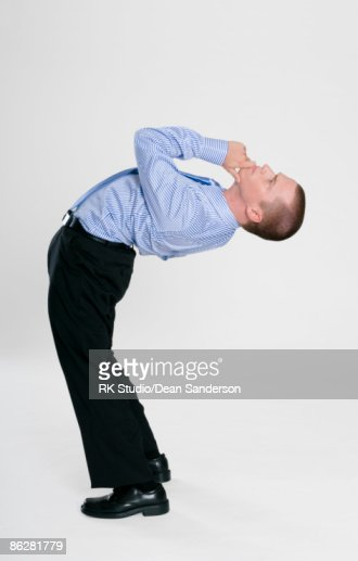 Flexible Businessman contorted, in thinking pose.