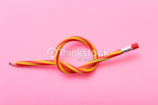 Flexible pencil on a pink background. Bent pencils two-color : Stock Photo