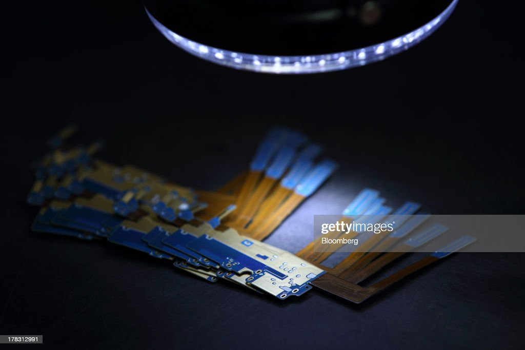 Flexible Printed Circuit Boards (F-PCB) sit on a counter on the production line at the Seil Electronics Co. factory in Incheon, South Korea, on Wednesday, Aug. 28, 2013. South Korea has surpassed Brazil, Russia and India to become the second-biggest emerging stock market for the first time since 2006, as a stable won and record current-account surplus lure investors. Photographer: SeongJoon Cho/Bloomberg via Getty Images