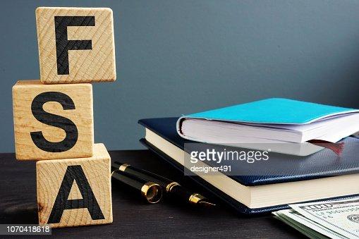 Flexible spending account FSA written on a wooden cubes. : Stock Photo