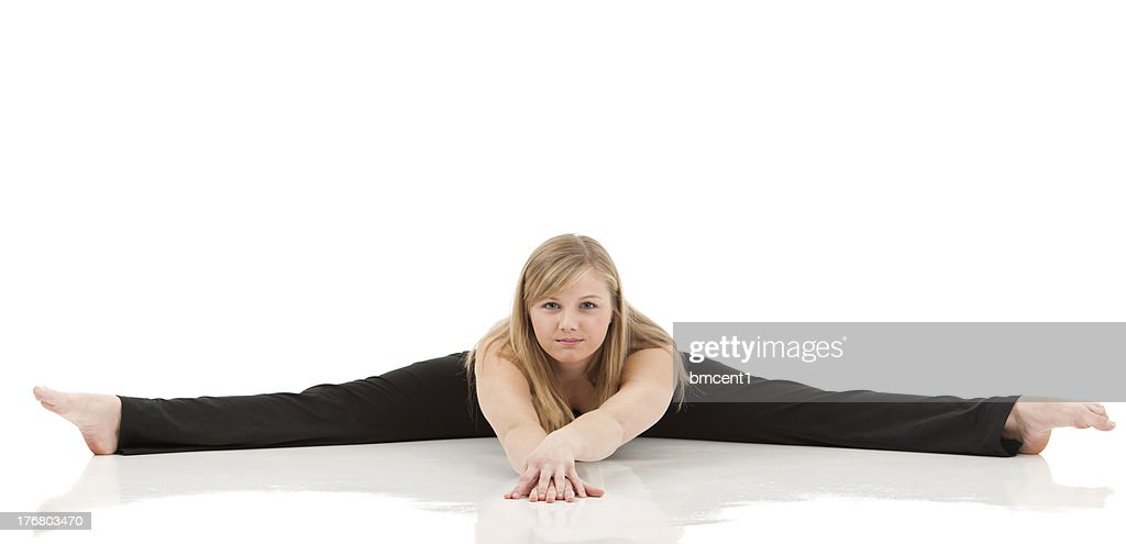 Flexible Woman Doing A Straddle Long Legs Stock Photo | Thinkstock