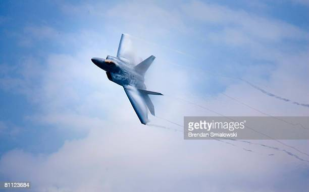 F22 flies during the Joint Services Open House and Air Show May 16 2008 at Andrews Air Force Base in Maryland Military families their guests and...