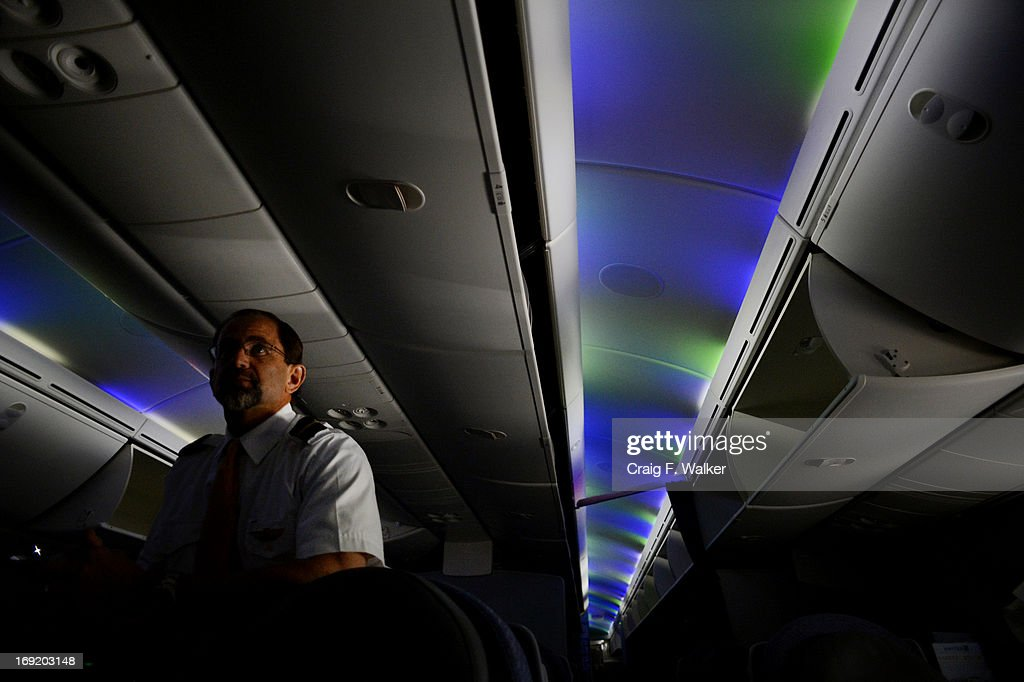 Flight attendant Brian McCarthy talks about the Boeing 787 Dreamliner while preparing for departure to Houston at Denver International Airport in Denver, CO May 21, 2013. The LED lights can simulate sunrise and sunset. It is the first flight from Denver after a delay caused by battery failures. The first international flight between DIA and Tokyo is scheduled for June 10.