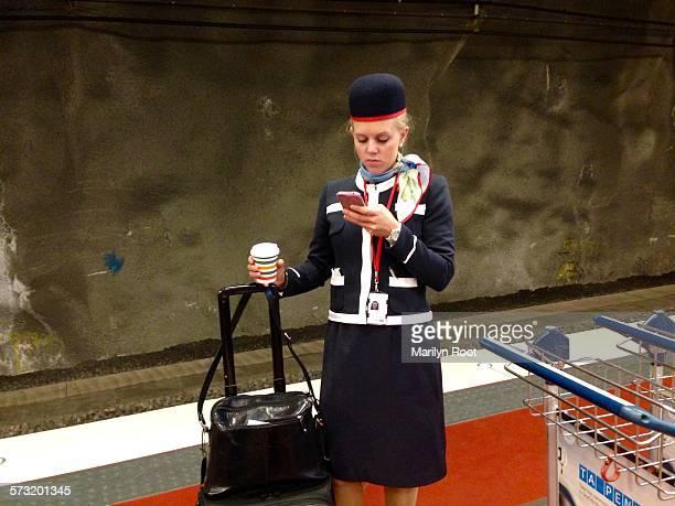 Flight attendant checking phone updating at arlanda airport Stockholm Sweden