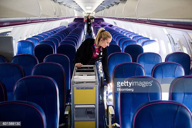 A flight attendant cleans the cabin after landing onboard a passenger aircraft operated by Wizz Air Holdings Plc at Liszt Ferenc airport in Budapest...
