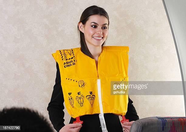 Flight Attendant Demonstrating Life Vest