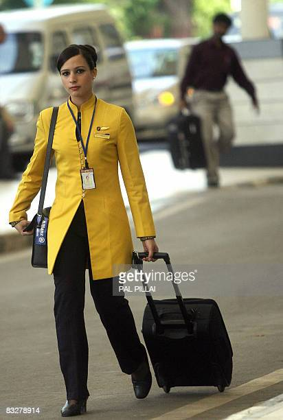 A flight attendant of India's Jet Airways pulls a luggage trolley as she leaves the domestic airport in Mumbai on October 15 2008 India's largest...