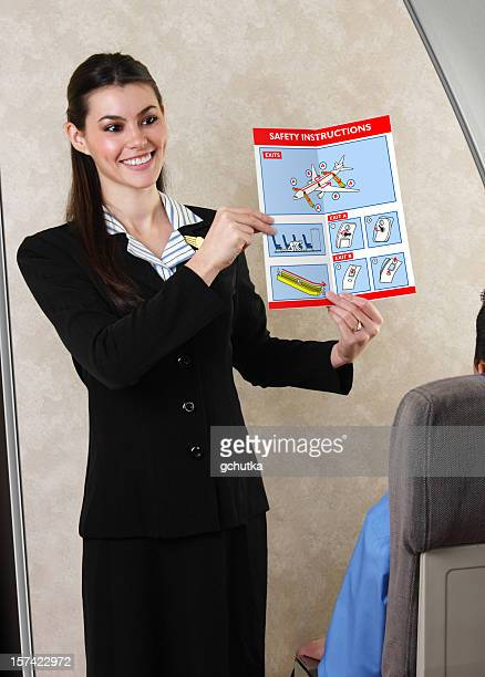 Flight Attendant Showing Safety Procedures