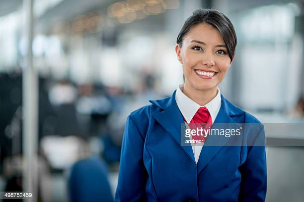 Flight attendant smiling