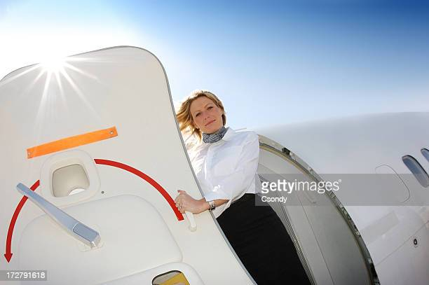 Flight attendant standing at the aircraft door