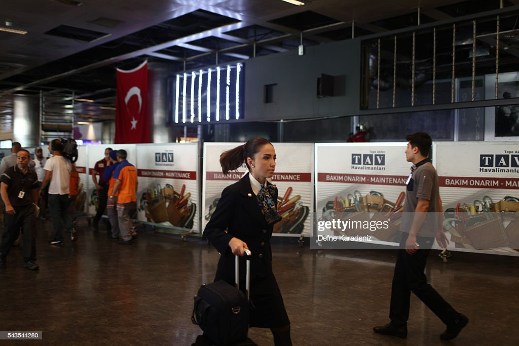 A flight attendant walks in the damaged parts of the international terminal of the country's largest airport, Istanbul Ataturk, following yesterday's blast on June 29, 2016 in Istanbul, Turkey. Three suicide bombers opened fire before blowing themselves up at the entrance to the main international airport in Istanbul yesterday. The Istanbul Governor's Office says 41 people have been killed, 37 of the victims have been identified, including 10 foreign nationals and three people with dual citizenship. More than 230 people were wounded but 109 have been discharged from hospitals in the deadly suicide bombing attack in Istanbul's Ataturk airport blamed on the Islamic State group.