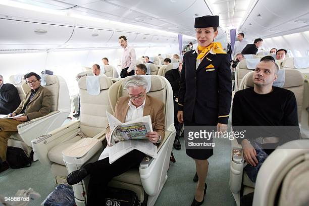 A flight attendant walks through the business class section of an Airbus A380 airplane on that model's first transatlantic flight from Frankfurt to...
