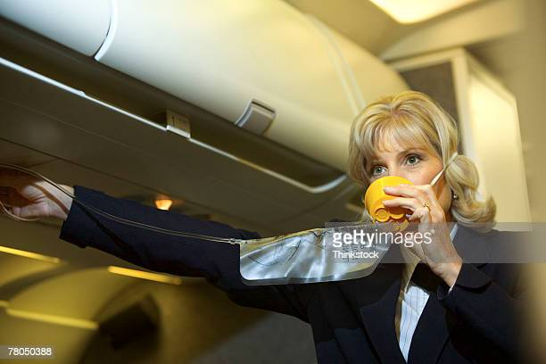Flight attendant with an oxygen mask