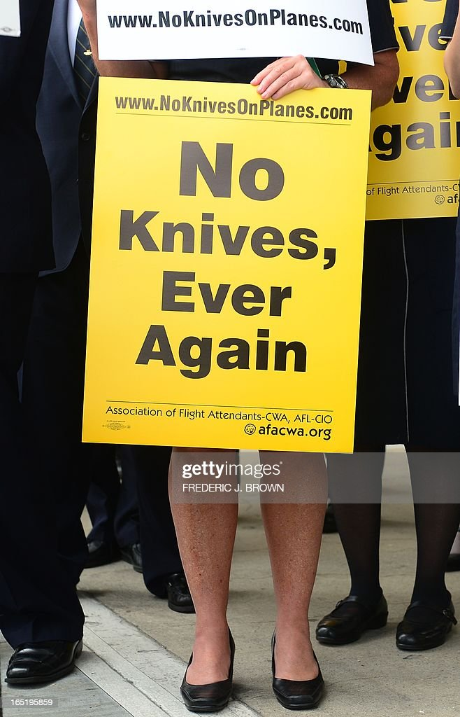 Flight attendants and various employees for U.S. airlines hold banners and placards while picketing at Los Angeles International Airport's departure level demanding that small knives be kept out of their cabins on April 1, 2013 in Los Angeles, California. The TSA recently announced plans to allow small pocket knives aboard planes, aiming to increase enforcement against larger potential weapons by not worrying about smaller implements. AFP PHOTO/Frederic J. BROWN