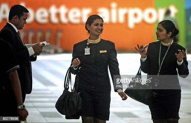 Flight attendants of India's Jet Airways walk out of the domestic airport in Mumbai on October 15 2008 India's largest privatesector carrier Jet...