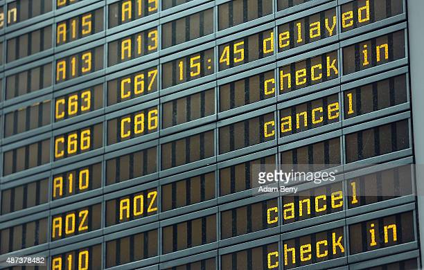 Flight cancellations are seen on an information board during a strike by Lufthansa pilots at Tegel airport on September 9 2015 in Berlin Germany...