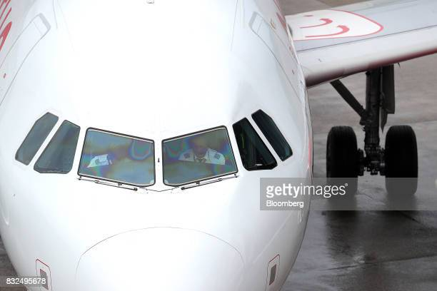 Flight crew sit in the cockpit of a passenger aircraft operated by Air Berlin Plc on the tarmac at Tegel airport in Berlin Germany on Wednesday Aug...