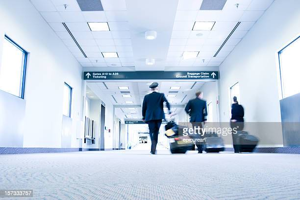 Flight crew walking through Raleigh (RDU) Airport