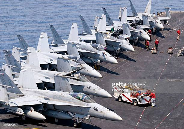 Flight deck crew prepare Boeing F/A18 Hornets for launch off the American aircraft carrier USS Enterprise on Saturday Aug 25 2007 The USS Enterprise...