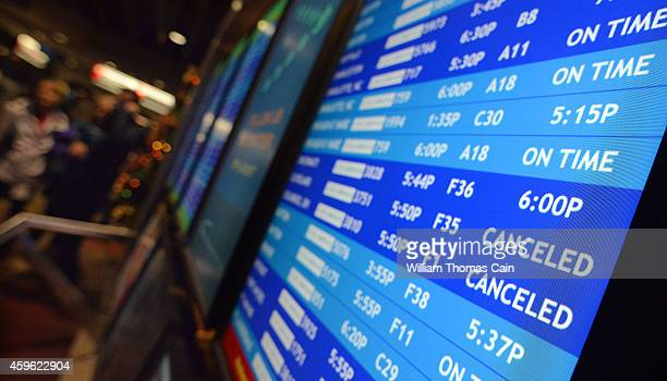 Flight departure displays indicate delayed or canceled fights at Philadelphia International Airport November 26 2014 in Philadelphia Pennsylvania A...