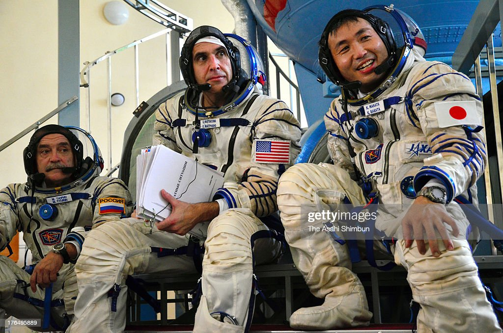 Flight Engineer Mikhail Tyurin of Russia, Flight Engineer Richard Mastracchio of USA and Commander <a gi-track='captionPersonalityLinkClicked' href=/galleries/search?phrase=Koichi+Wakata&family=editorial&specificpeople=220363 ng-click='$event.stopPropagation()'>Koichi Wakata</a> of Japan speak to media reporters at Yuri Gagarin Cosmonaut Training Center on August 12, 2013 in Moscow, Russia. Wakata is appointed as the commander of Expedition 39 of the International Space Station (ISS), that will launch in November.