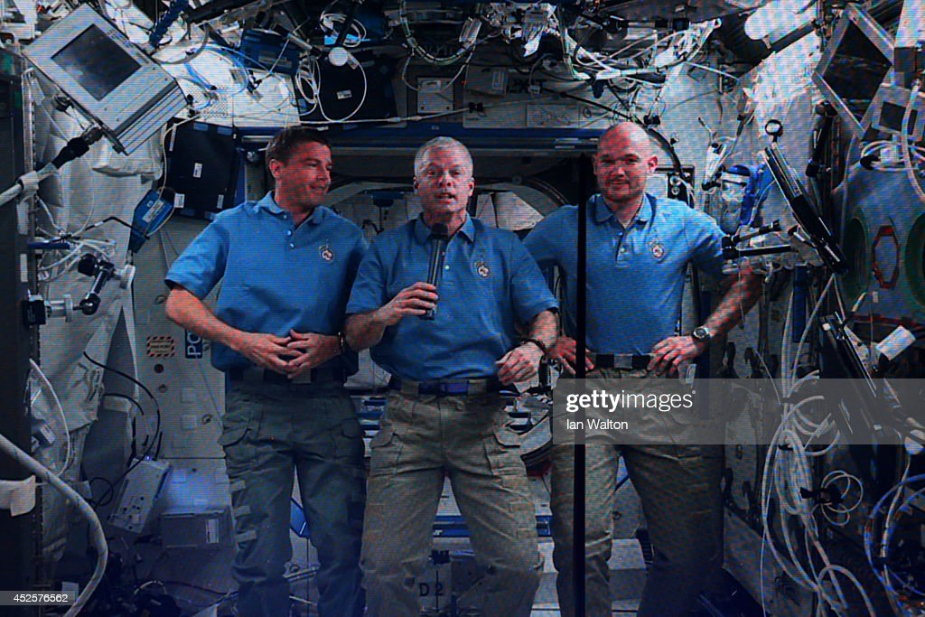 Flight Engineer Reid Wiseman, Commander Steve Swanson, Flight Engineer <a gi-track='captionPersonalityLinkClicked' href=/galleries/search?phrase=Alexander+Gerst&family=editorial&specificpeople=5862799 ng-click='$event.stopPropagation()'>Alexander Gerst</a> of the International Space Station speak via videolink during the Opening Ceremony for the Glasgow 2014 Commonwealth Games at Celtic Park on July 23, 2014 in Glasgow, Scotland.
