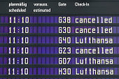 Flight information board is pictured during a strike by Lufthansa pilots at Munich Airport on September 10 2014 in Munich Germany Today's strike...