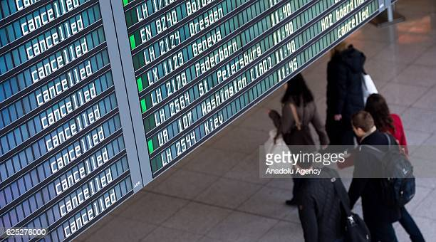 A flight information board shows cancelled flights as the Lufthansa airlines' pilots strike continues at the Airport in Munich Germany on November 23...