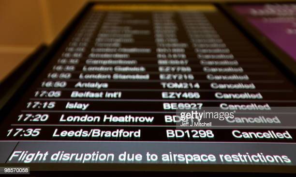 Flight information screens show further cancellations at Glasgow Airport after it closed once again despite the resumption of a limited number of...