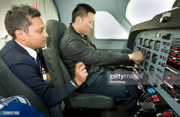 Flight instructor Mark McGregor teaches in a flight simulator at Singapore Airlines Ltd's Flying College at Jandakot Airport in Perth Australia on...