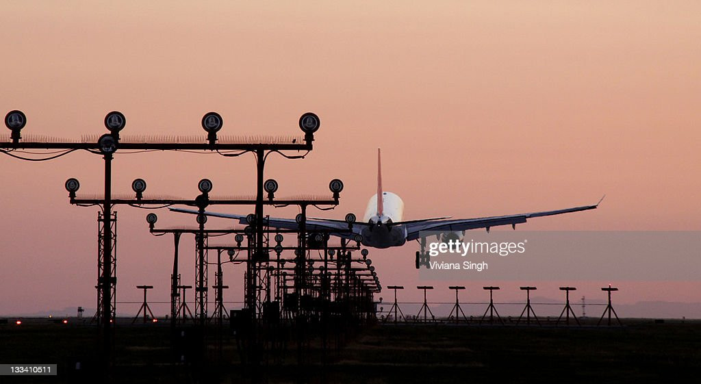 Flight landing at airport : Stock Photo