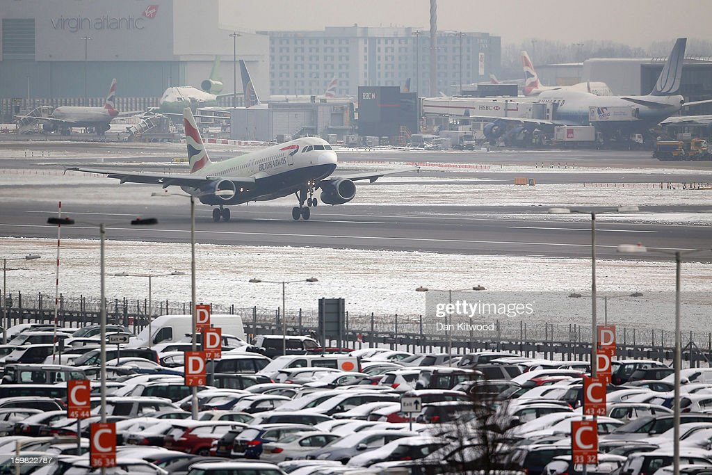 A BA flight leaves Heathrow airport on January 21, 2013 in London, England. Around 260 flights have been cancelled today from Heathrow due to snow and poor visibility.
