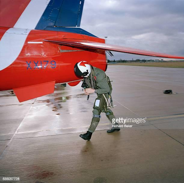 Flight Lieutenant Simon Stevens a pilot in the elite 'Red Arrows' Britain's prestigious Royal Air Force aerobatic team makes a preflight check of his...