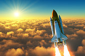 Flight Of The Space Shuttle Above The Clouds In The Rays Of The Rising Sun. 3D Illustration.