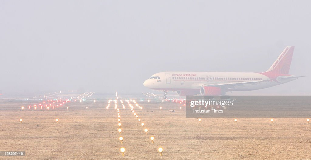 A flight on a way to take off after little clear visibility at CAT-2 enabled runway of Shri Guru Ram Dass Ji International Airport on December 24, 2012 in Amritsar, India. Heavy fog in the region causes several flights and trains delayed.