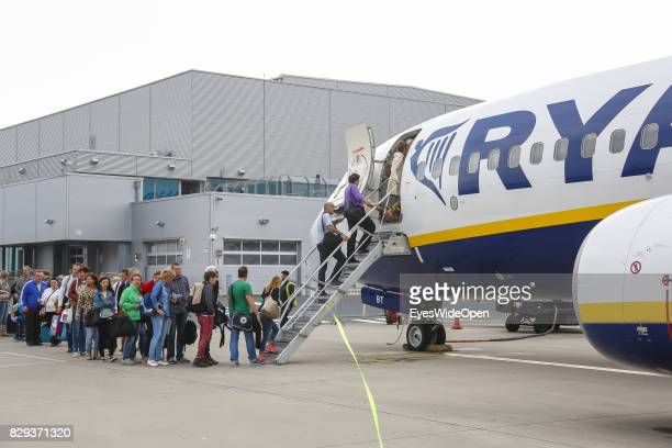 Flight passengers boarding at the Airport Weeze where Ryan Air offers flights to Sardinia on September 08 2014 in Weeze Germany