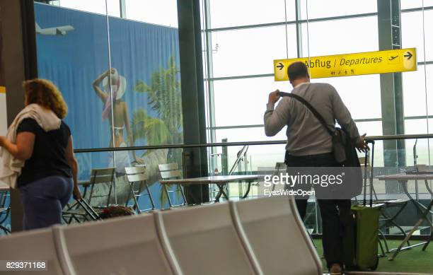 Flight passengers checkin at the Airport Weeze where Ryan Air offers flights to Sardinia on September 08 2014 in Weeze Germany