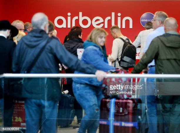 Flight passengers crowd in front of the desk of German airline Air Berlin at the airport in Duesseldorf western Germany on September 12 after the...