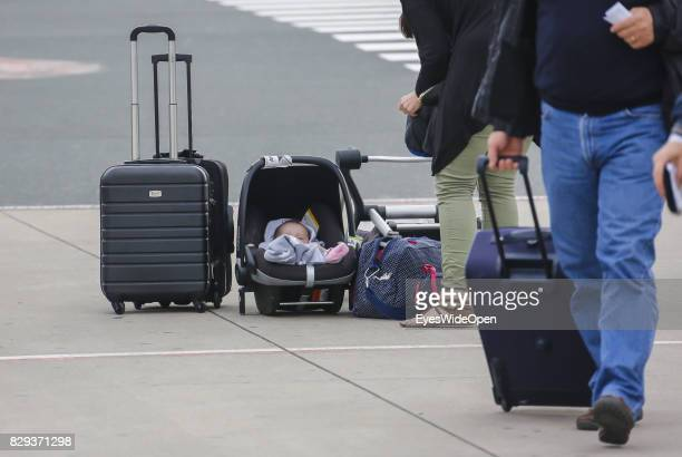 Flight passengers with baby at the Airport Weeze where Ryan Air offers flights to Sardinia on September 08 2014 in Weeze Germany