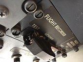 A closeup of flight recorder system of an aircraft