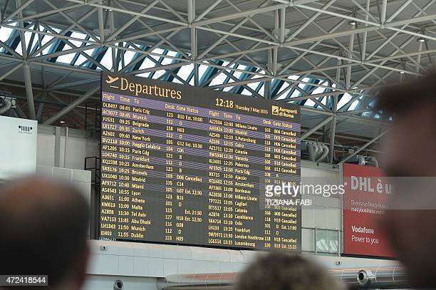 A flights information screen shows cancelled flights at Rome's Fiumicino international airport where a fire broke out overnight at Terminal 3 on May...