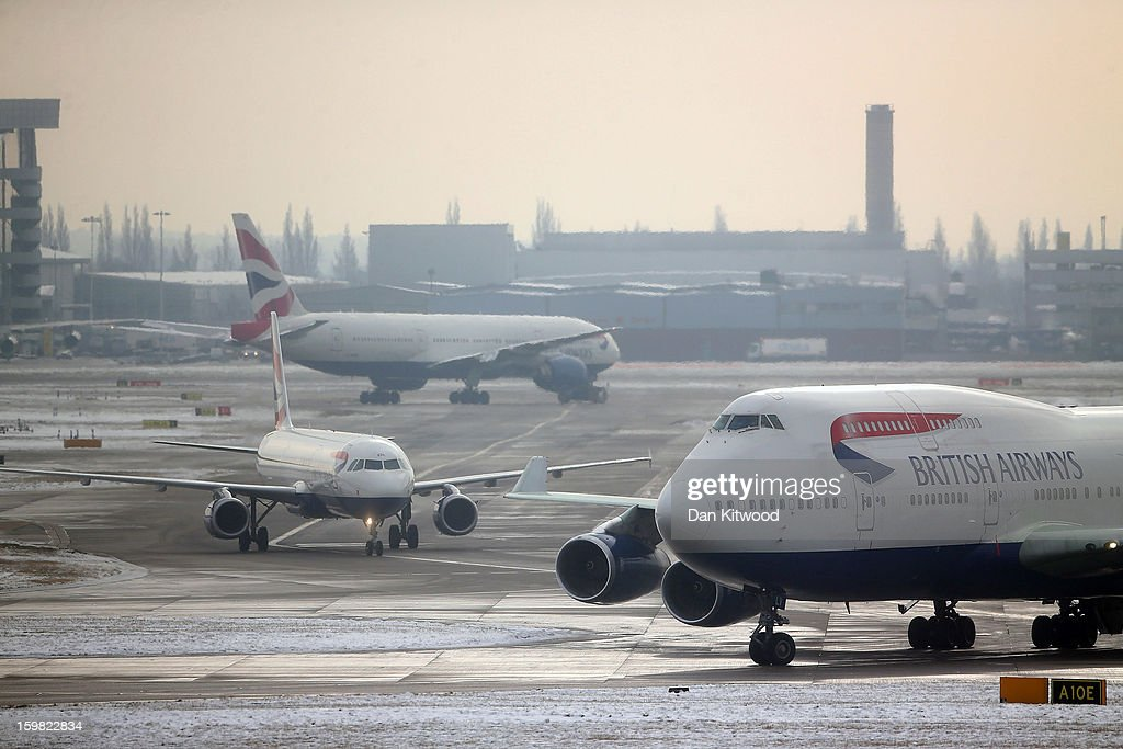 BA flights prepare for departure from Heathrow airport on January 21, 2013 in London, England. Around 260 flights have been cancelled today from Heathrow due to snow and poor visibility.