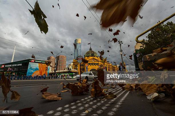 Flinders St station and passerbys are caught in a storm of autumn leaves as wind gusts of up to 100km per hour are expected on May 3 2016 in...