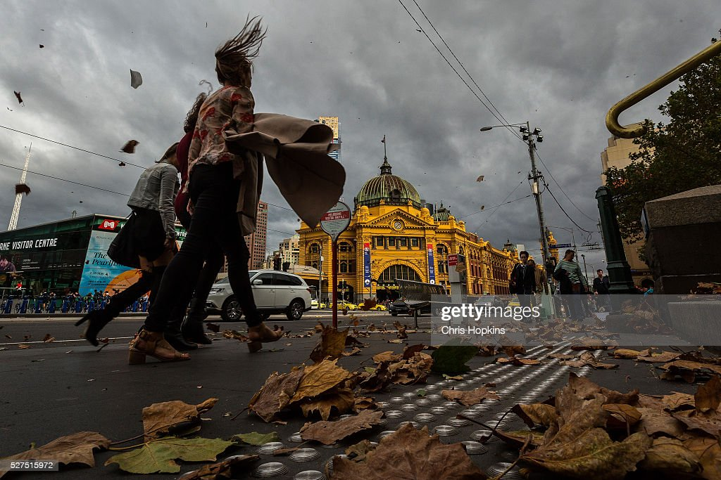 Flinders St station and passer-bys are caught in a storm of autumn leaves as wind gusts of up to 100km per hour are expected on May 3, 2016 in Melbourne, Australia.