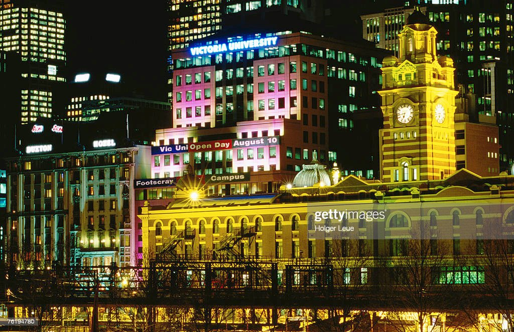 Flinders Street Station and other city buildings illuminated at night, Melbourne, Victoria, Australia, Australasia