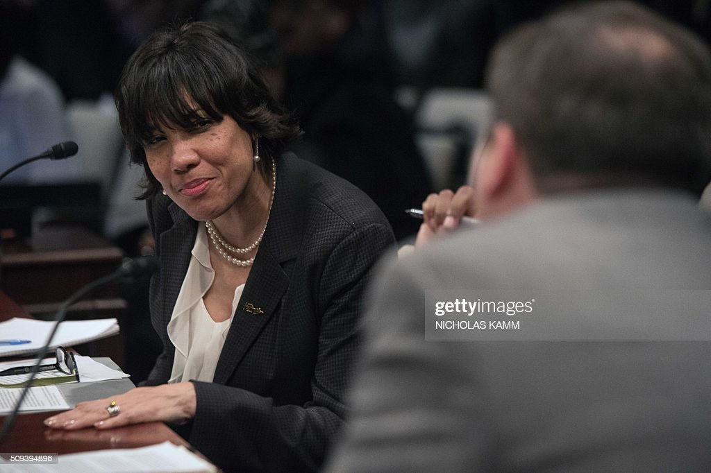 Flint mayor Karen Weaver speaks with other panelists during a break in a House Democratic Steering and Policy Committee hearing on the Flint, Michigan, water crisis on Capitol Hill in Washington, DC, on February 10, 2016. / AFP / NICHOLAS KAMM