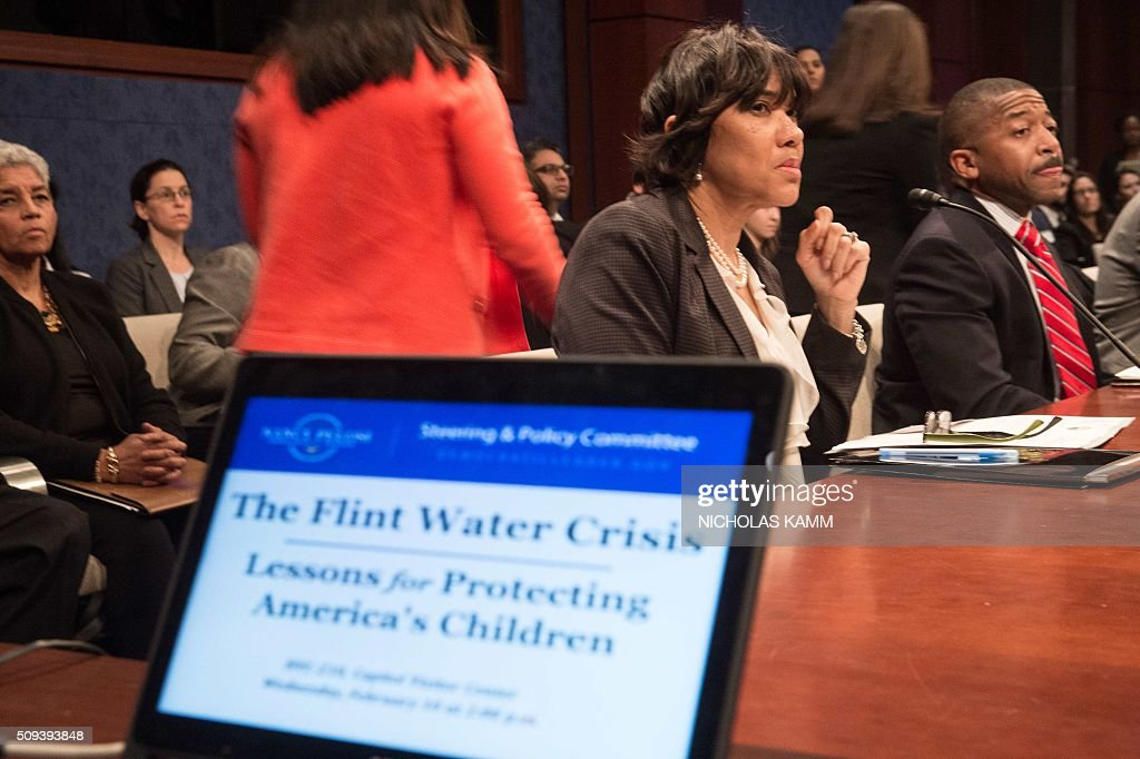 Flint mayor Karen Weaver (L) waits for the start of a House Democratic Steering and Policy Committee hearing on the Flint, Michigan, water crisis on Capitol Hill in Washington, DC, on February 10, 2016. / AFP / NICHOLAS KAMM