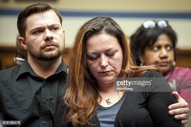 Flint Michigan resident Lee Anne Walters center and her husband Dennis Walters react as Rick Snyder governor of Michigan not pictured testifies...