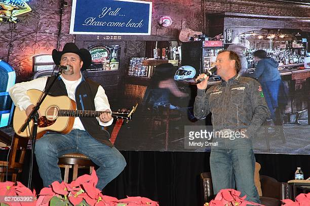 Flint Rassmussen sings with Daryle Singletary during the 'Keepin' it Country with Daryle Singletary' show during the National Finals Rodeo's Cowboy...